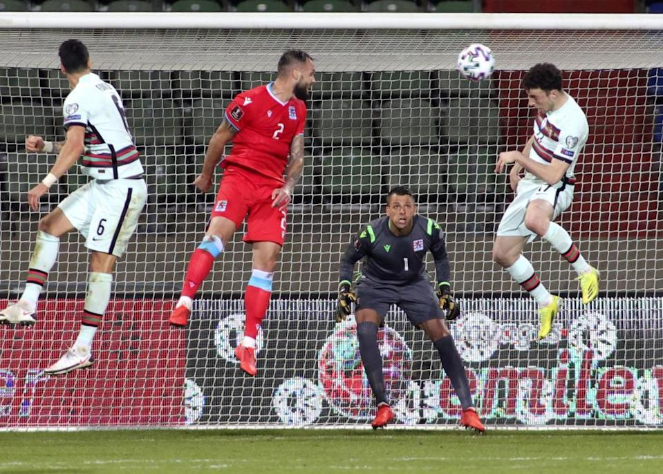 Diogo Jota, right, leaps to scoring against Luxembourg.