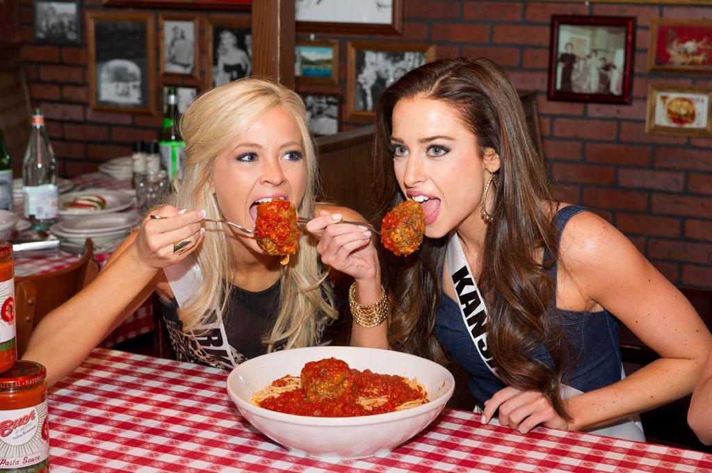 Miss Arkansas USA 2013, Hannah Billingsley; and Miss Kansas USA 2013, Staci Klinginsmith; try some of Buca di Beppo famous meatballs during a welcome dinner in Las Vegas, Nevada on Wednesday June 5, 2013.