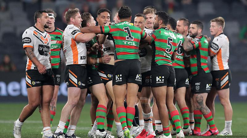Players, pictured here coming together in fiery scenes between the Rabbitohs and Tigers.
