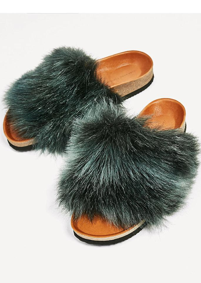 "Zara Flat Furry Sandals, $49.90; at <a rel=""nofollow"" href=""http://www.zara.com/us/en/woman/shoes/view-all/flat-furry-sandals-c719531p4277503.html"">Zara</a>"