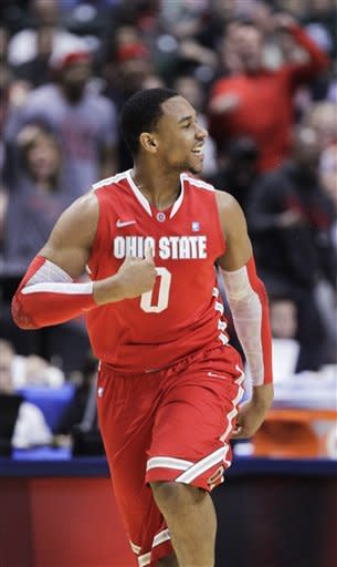 Ohio State forward Jared Sullinger reacts in the second half of an NCAA college basketball game against Michigan State in the final of the Big Ten Conference men's tournament in Indianapolis, Sunday, March 11, 2012. (AP Photo/Michael Conroy)
