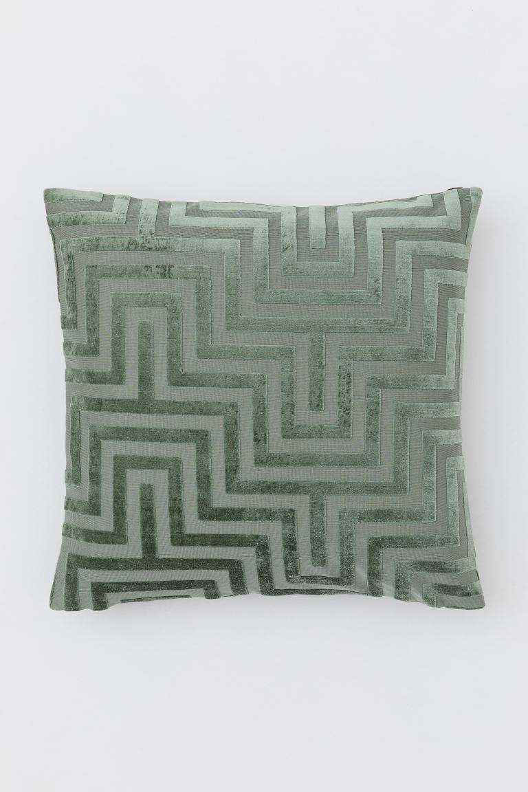 """Douse your couch in silky sophistication with a seafoam velvet pillow featuring an intricate burnout pattern.<br><br><strong>Foamily</strong> Hypoallergenic Pillow Insert (20X20), $, available at <a href=""""https://www.amazon.com/Foamily-Premium-Hypoallergenic-Polyester-Standard/dp/B0106UAM3I/ref=sr_1_3"""" rel=""""nofollow noopener"""" target=""""_blank"""" data-ylk=""""slk:Amazon"""" class=""""link rapid-noclick-resp"""">Amazon</a><br><br><strong>H&M</strong> Velvet Cushion Cover, $, available at <a href=""""https://go.skimresources.com/?id=30283X879131&url=https%3A%2F%2Fwww2.hm.com%2Fen_us%2Fproductpage.0704900007.html"""" rel=""""nofollow noopener"""" target=""""_blank"""" data-ylk=""""slk:H&M"""" class=""""link rapid-noclick-resp"""">H&M</a>"""