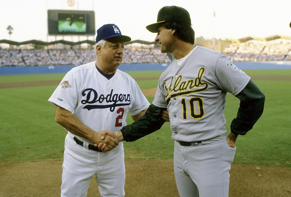Tommy Lasorda of the Los Angeles Dodgers shakes hands with manager Tony LaRussa of the Oakland Athletics at home-plate before game 2 of the 1988 World Series, October 16, 1988 at Dodger Stadium in Los Angeles, California. The Dodgers won the series 4-1. (Photo by Focus on Sport/Getty Images)
