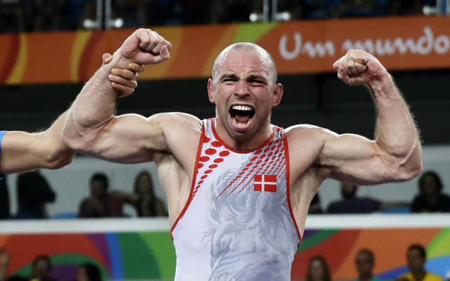 <p>Denmark's Mark Overgaard Madsen reacts after winning against Hungary's Peter Bacsi a semi-final of the men's Greco-Roman wrestling 75-kg competition at the 2016 Summer Olympics in Rio de Janeiro, Brazil, Sunday, Aug. 14, 2016. (AP Photo/Markus Schreiber) </p>