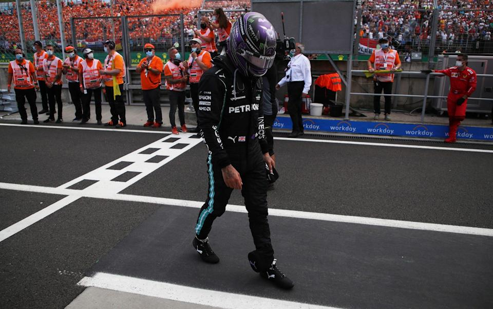 A struggling Lewis Hamilton walks off - GETTY IMAGES