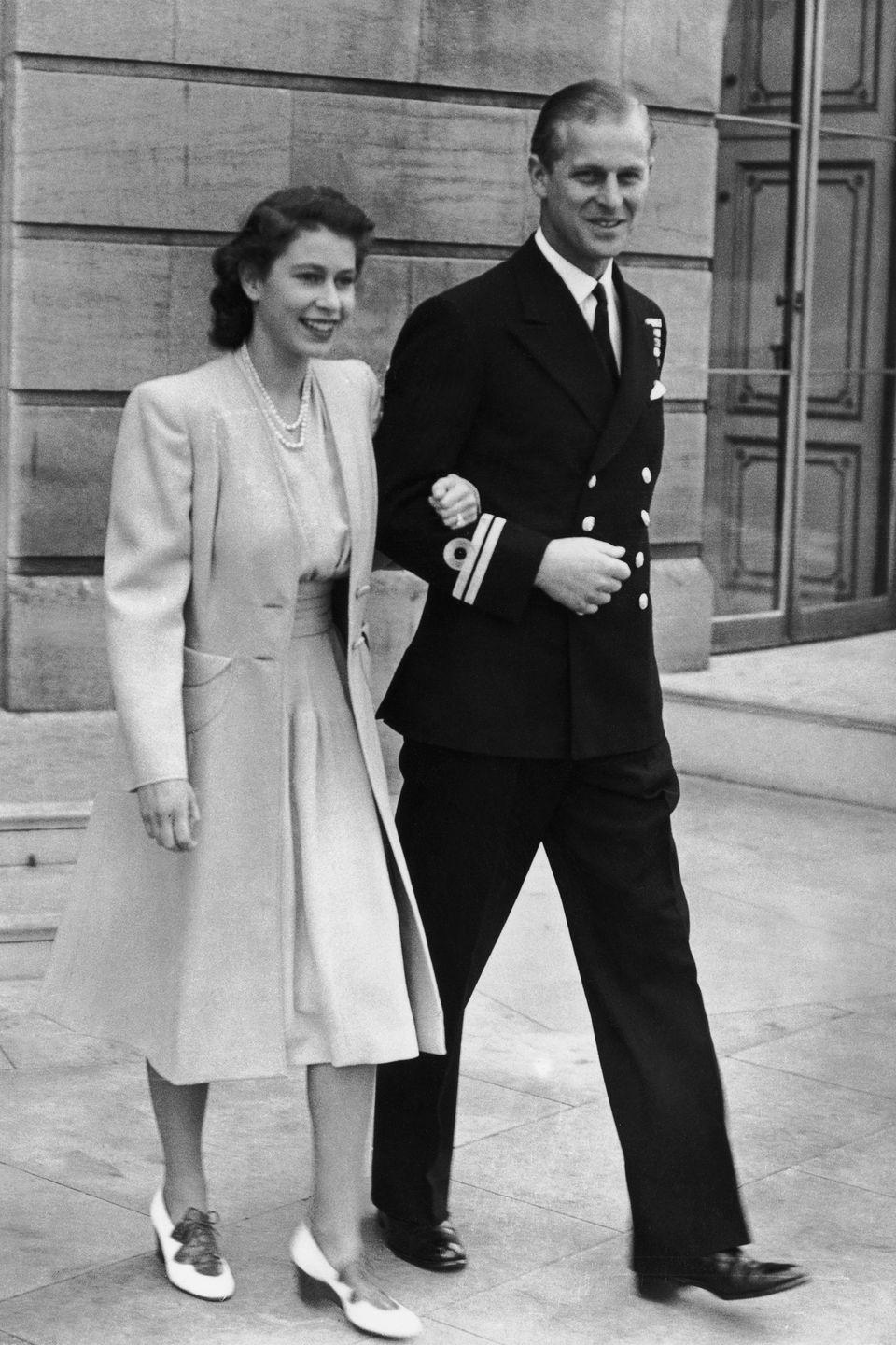 <p>Princess Elizabeth and the Duke of Edinburgh are photographed for the first time since the announcement of their engagement in the summer of 1947. </p>