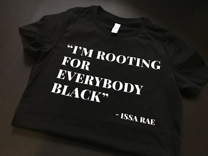 "Get the <a href=""https://knowdefinition.com/product/im-rooting-for-everybody-black-t-shirt/"" rel=""nofollow noopener"" target=""_blank"" data-ylk=""slk:&quot;I'm Rooting For Everybody Black&quot; T-shirt from Know Definition for $30"" class=""link rapid-noclick-resp"">""I'm Rooting For Everybody Black"" T-shirt from Know Definition for $30 </a>"