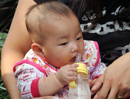 A Chinese baby drinks coconut milk mixed with water instead of baby formula