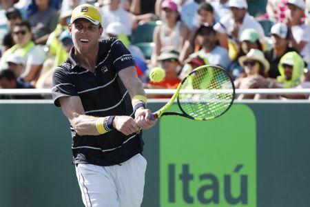 FILE PHOTO: Mar 26, 2018; Key Biscayne, FL, USA; Sam Querrey of the United States has a backhand against Denis Shapovalov of Canada (not pictured) on day seven of the Miami Open at Tennis Center at Crandon Park. Geoff Burke-USA TODAY Sports