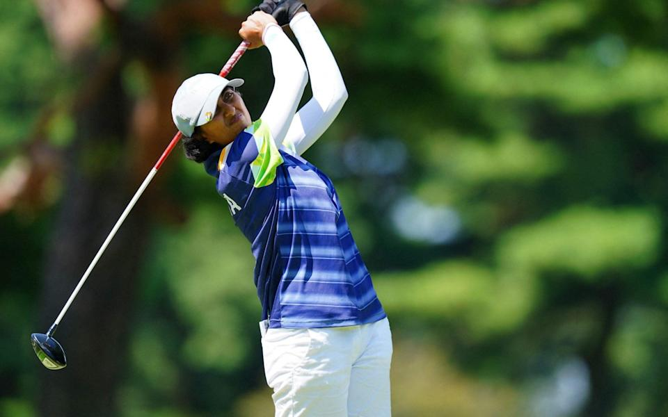 India's Aditi Ashok watches her drive from the 5th tee in round 3 of the womens golf individual stroke play. - YOSHI IWAMOTO / AFP