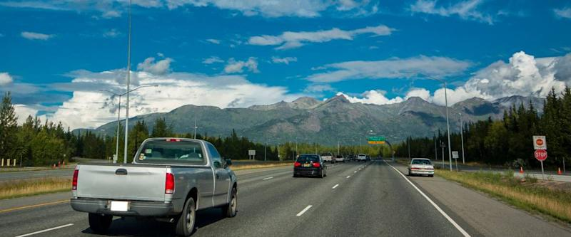 Traffic near Anchorage on Alaskan road in good weather with cars on freeway