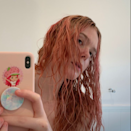 """<p>Once stay-at-home orders went into full effect, celebrities, bored like the rest of us (except in their mansions), started dyeing their hair themselves. <a href=""""https://www.allure.com/gallery/best-pink-hair-dyes-and-tints?mbid=synd_yahoo_rss"""" rel=""""nofollow noopener"""" target=""""_blank"""" data-ylk=""""slk:The color of choice"""" class=""""link rapid-noclick-resp"""">The color of choice</a>? Pink. """"Pinks are so dreamy, light, and fun,"""" says New York City-based colorist <a href=""""https://www.instagram.com/colorbyjulz/"""" rel=""""nofollow noopener"""" target=""""_blank"""" data-ylk=""""slk:Julia Elena"""" class=""""link rapid-noclick-resp"""">Julia Elena</a>, who has recently tried the hue on herself. """"I actually had pink around May during isolation, and I felt my soul lifted."""" </p> <p>Elle Fanning was one of the first celebrities to dye her hair pink, which she gracefully documented for us on her Instagram page. Hers has a peachy tint to it, a version of the color that Elena says she's been seeing a lot of. </p>"""