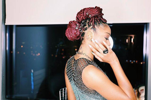 "<p>Switch up from a classic bun to an elegant updo. Gather your braids into two or three mini space buns similar to KeKe Palmer's ruby toned 'do. </p><p><a href=""https://www.instagram.com/p/BPDGtsAD_T1/?utm_source=ig_embed&utm_campaign=loading"" rel=""nofollow noopener"" target=""_blank"" data-ylk=""slk:See the original post on Instagram"" class=""link rapid-noclick-resp"">See the original post on Instagram</a></p>"