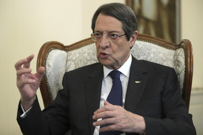 "Cyprus' president Nicos Anastasiades talks during an interview with the Associated Press at the presidential palace in capital Nicosia, Cyprus, Tuesday Sept. 17, 2019. Anastasiades says Turkey's ""obsession"" to permanently station troops, secure military intervention rights and extend its influence over Turkish Cypriots in any peace deal is fanning fears that it wants to turn the island into a ""protectorate."" (AP Photo/Petros Karadjias)"