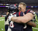 Houston Texans quarterback Deshaun Watson (4) and defensive end J.J. Watt (99) embrace after their win over the Jacksonville Jaguars in an NFL football game, Sunday, Dec. 30, 2018, in Houston. (AP Photo/David J. Phillip)