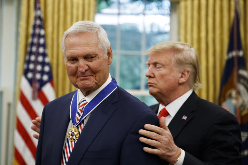 President Donald Trump, right, presents the Presidential Medal of Freedom to former NBA basketball player and general manager Jerry West, in the Oval Office of the White House, Thursday, Sept. 5, 2019, in Washington. (AP Photo/Alex Brandon)