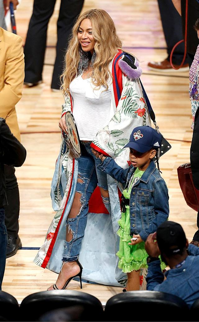<p>Again, ripped jeans paired with a glam top — in this case a fancy duster. This was her look for the 2017 NBA All-Star Game in New Orleans, La., on Feb. 19, and if you think the top looked fancy, you're right. It was a $22,000 Gucci kimono. (Photo: Jonathan Bachman/Getty Images) </p>