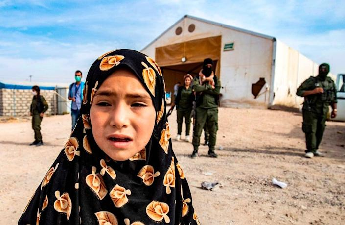 A Syrian child, suspected of being related to Isis, at the al-Hol camp before being released to return to her home in al-Hasakah (AFP/Getty)