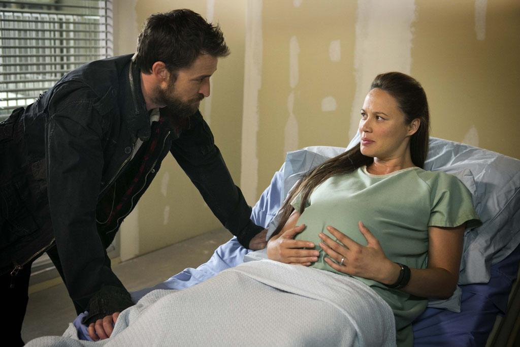 "Noah Wyle and Moon Bloodgood in the ""Falling Skies"" Season 3 Premiere, ""On Thin Ice."""
