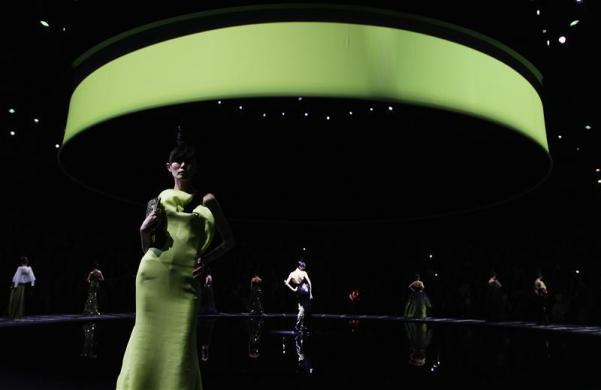 Models present creations for the Giorgio Armani fashion show in Beijing, May 31, 2012.