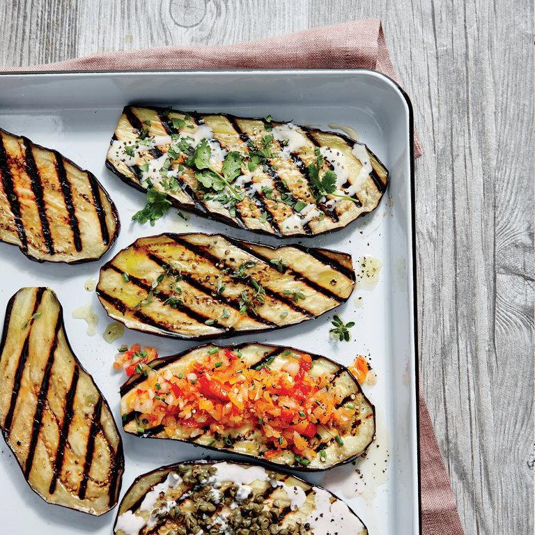 """Grill more than meats this summer. Veggies like grilled eggplant make a simple summer side dish to accompany any cookout.  <a rel=""""nofollow"""" href=""""http://www.myrecipes.com/recipe/grilled-eggplant-planks-creole-salsa"""">Grilled Eggplant Planks with Creole Salsa </a>"""