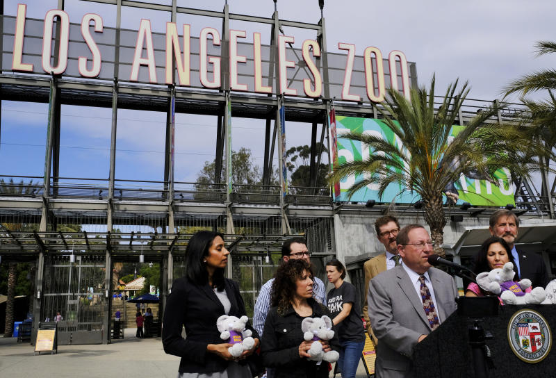 Los Angeles City Councilman Paul Koretz, flanked by activists from several animal-welfare advocacy groups, talks during a news conference at the Los Angeles Zoo on Tuesday, April 18, 2017. Koretz, wants to move an Asian elephant from the Los Angeles Zoo to a sanctuary where it can roam more widely, but zoo officials say its habitat is state of the art. Koretz said Tuesday he will introduce a plan for moving Billy the elephant at Wednesday's council meeting. (AP Photo/Richard Vogel)