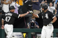 Chicago White Sox's Jose Abreu, right, celebrates with third base coach Joe McEwing after hitting a three-run home run during the sixth inning of the team's baseball game against the Houston Astros in Chicago, Saturday, July 17, 2021. (AP Photo/Nam Y. Huh)