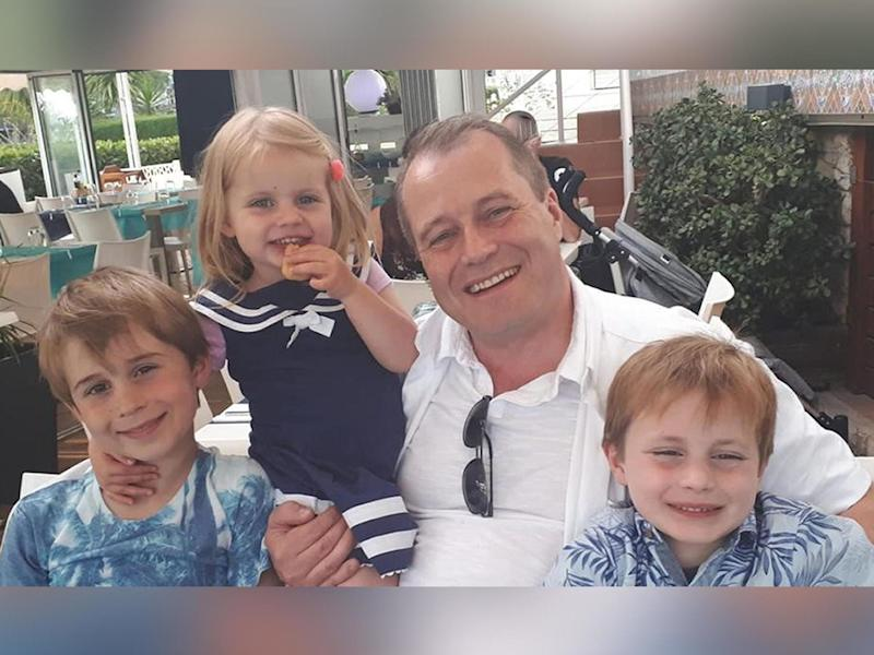 Conor McGinley, 9, Darragh McGinley, 7, and Carla McGinley, 3, with their father Andrew McGinley. The three children were found dead in a house in Parson's Court, in the village of Newcastle on Friday evening: PA