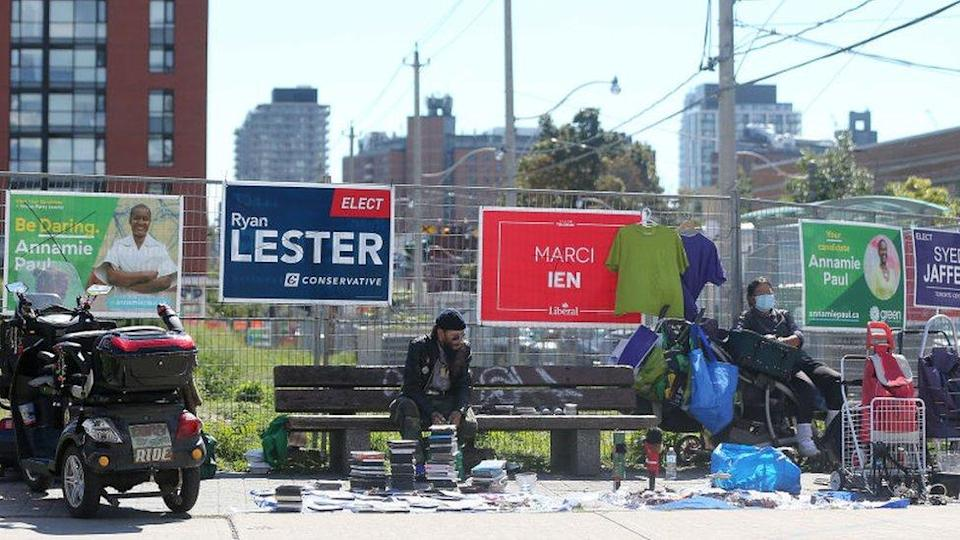 Election campaign signs cover the fencing on a lot near Gerrard and Parliament Streets in Toronto. September 16, 2021