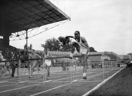 """The 110 meters hurdles during the London Olympics in 1948. London in 1948 was a city recovering from the severe damage inflicted by the """"blitzkreig"""" Nazi German bombardment. The athletes slept in military barracks and boarding schools, engendering a strong team spirit"""