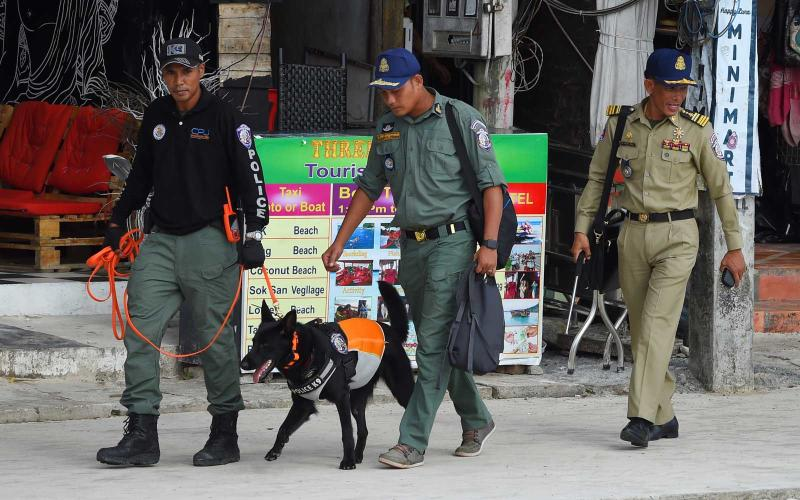 A police dog team leaves to continue the search for missing British tourist Amelia Bambridge on Koh Rong island in Sihanoukville province on October 31, 2019. | TANG CHHIN SOTHY/Getty Images