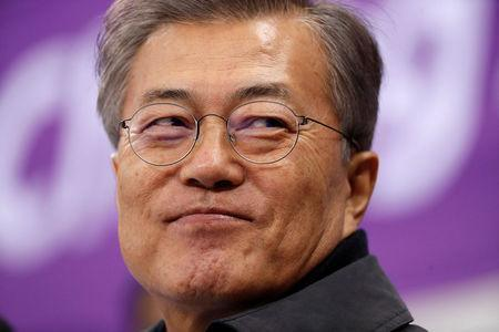 FILE PHOTO: Short Track Speed Skating Events - Pyeongchang 2018 Winter Olympics - Women's 1500m - Gangneung Ice Arena - Gangneung, South Korea - February 17, 2018 - South Korea's President Moon Jae-in attends. REUTERS/John Sibley/File Photo