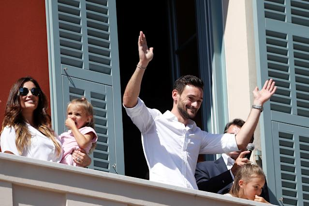 France soccer team goalkeeper Hugo Lloris surrounded by his wife Marine, their children Anna-Rose and Giuliana, and with Christian Estrosi, Mayor of Nice, waves to the crowd from a balcony at the city hall in Nice, after their victory in the 2018 Russia Soccer World Cup, in Nice, France, July 18, 2018. REUTERS/Eric Gaillard