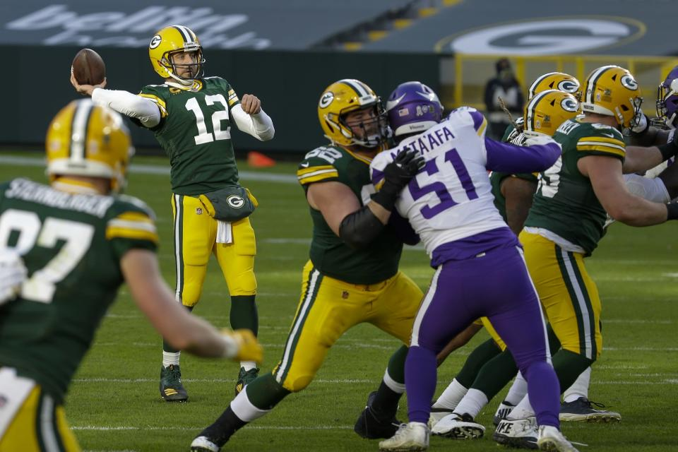 Green Bay Packers' Aaron Rodgers throws a touchdown pass to Davante Adams during the second half of an NFL football game against the Minnesota Vikings Sunday, Nov. 1, 2020, in Green Bay, Wis. (AP Photo/Mike Roemer)