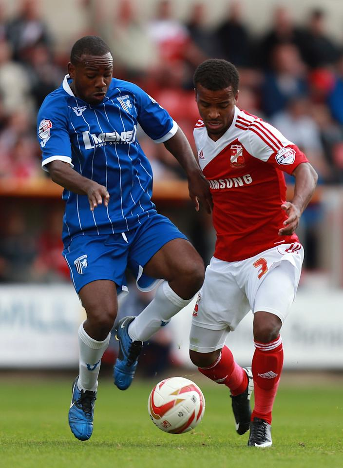 Swindon Town's Nathan Byrne is challenged by Gillingham's Myles Weston during the Sky Bet Football League One match at the County Ground, Swindon.
