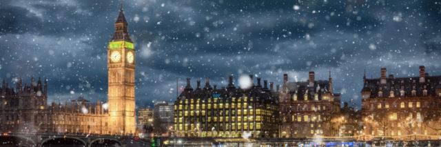 Big Ben and Westminster on a cold winter night with falling snow, London, United Kingdom