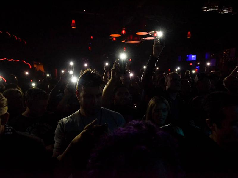 Phones should be switched off at concerts, not just put on mute (Alamy)