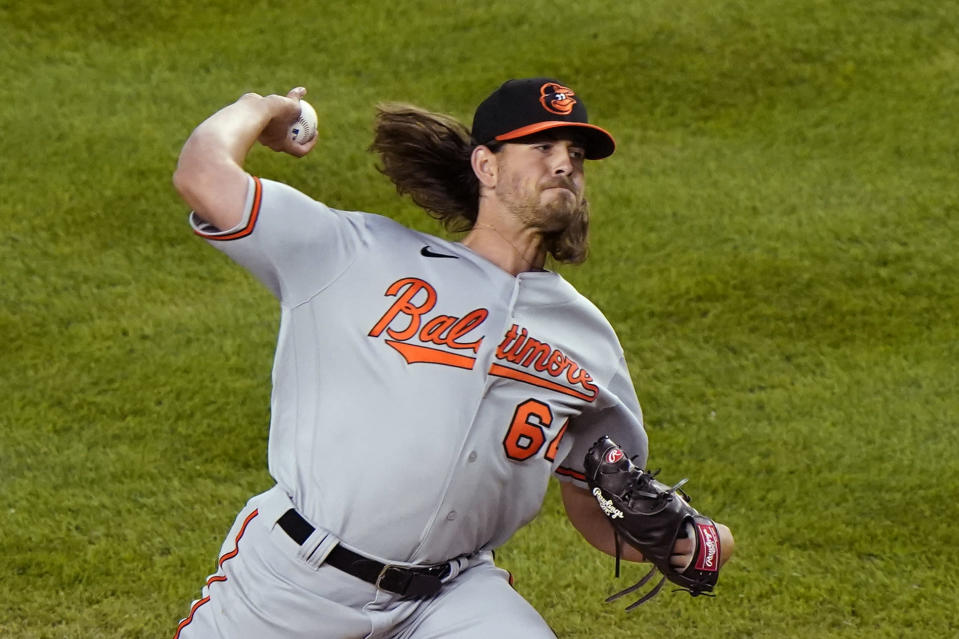 Baltimore Orioles starting pitcher Dean Kremer (64) winds up during the third inning of a baseball game against the New York Yankees, Tuesday, April 6, 2021, at Yankee Stadium in New York. (AP Photo/Kathy Willens)
