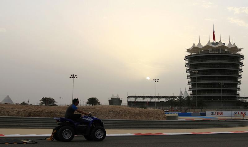 Track preparations are underway at the Bahrain International Circuit in Sakhir, Bahrain, on Wednesday, April 17, 2013. The F1 Bahrain Grand Prix will be held on Sunday. (AP Photo/Hasan Jamali)