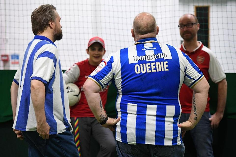 Players from the gay supporters' teams of Arsenal and Brighton take part in a penalty shoot-out competition at the Arsenal Hub in north London on October 1, 2017, ahead of the Premier League game between the two teams (AFP Photo/Chris J RATCLIFFE)