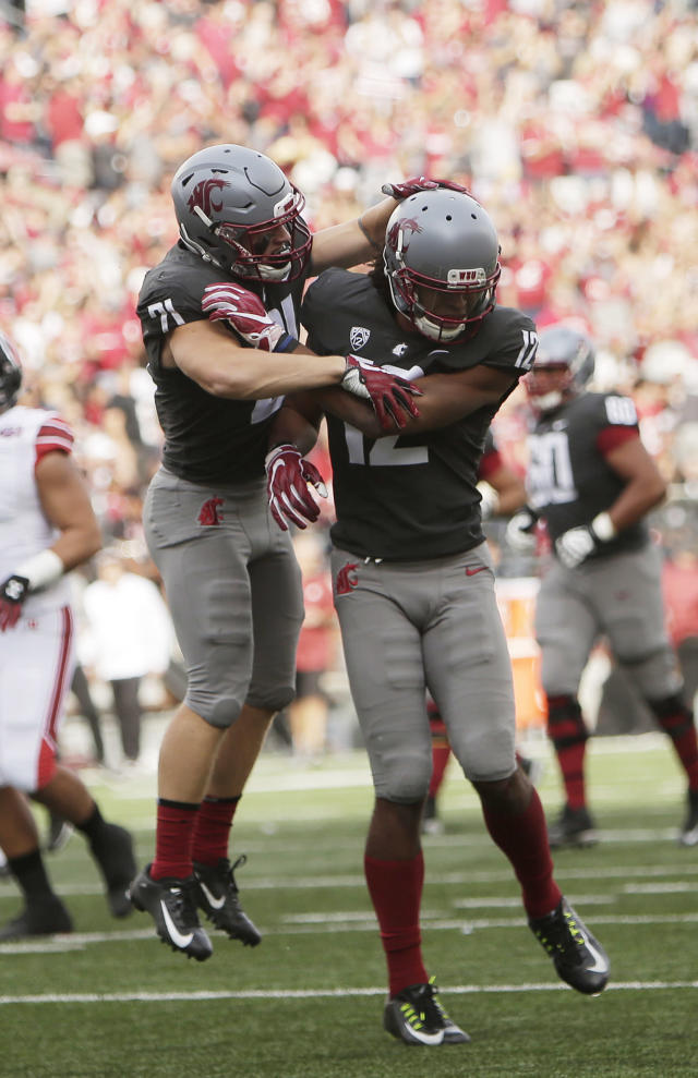 Washington State wide receiver Dezmon Patmon, right, celebrates his touchdown with running back Max Borghi during the first half of an NCAA college football game against Utah in Pullman, Wash., Saturday, Sept. 29, 2018. (AP Photo/Young Kwak)