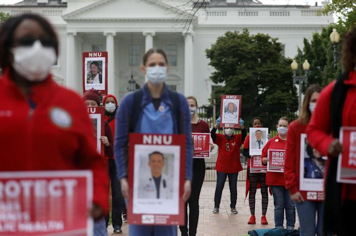 Registered Nurses and members of National Nurses United (NNU), the largest U.S. nurses union, rally on behalf of health care workers nationwide who have become infected with the coronavirus disease (COVID-19) and call on the Trump administration to order the mass production of personal protective equipment (PPE) during a protest outside of the White House in Washington, U.S., April 21, 2020. REUTERS/Leah Millis TPX IMAGES OF THE DAY
