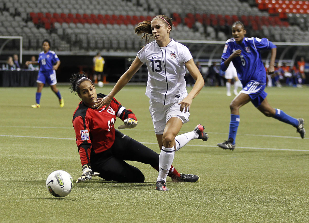 VANCOUVER, CANADA - JANUARY 20: Heidy Salazar #12 of the Dominican Republic watches as Alex Morgan #13 of the United States kicks the ball for a goal during their game at the CONCACAF Women's Olympic Qualifying Tournament at BC Place on January 20, 2012 in Vancouver, British Columbia, Canada. (Photo by Jeff Vinnick/Getty Images)