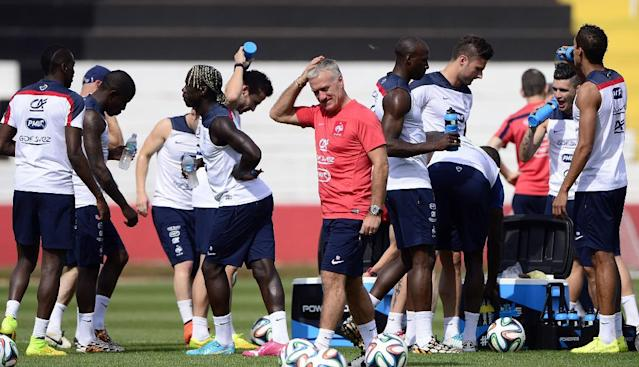 France's coach Didier Deschamps (C) and his players take part in a training session at the stadium Santa Cruz in Ribeirao Preto, Brazil, on June 28, 2014, during the FIFA World Cup (AFP Photo/Franck Fife)