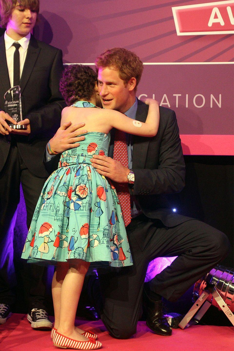 <p>These brothers are too damn lovable! In 2012, Prince Harry hugged a little girl at the WellChild Awards in London. </p>