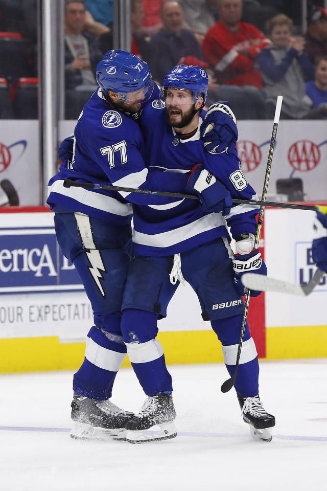 Tampa Bay Lightning right wing Nikita Kucherov (86) celebrates his goal with Victor Hedman (77) in the third period of an NHL hockey game against the Detroit Red Wings, Thursday, March 14, 2019, in Detroit. (AP Photo/Paul Sancya)