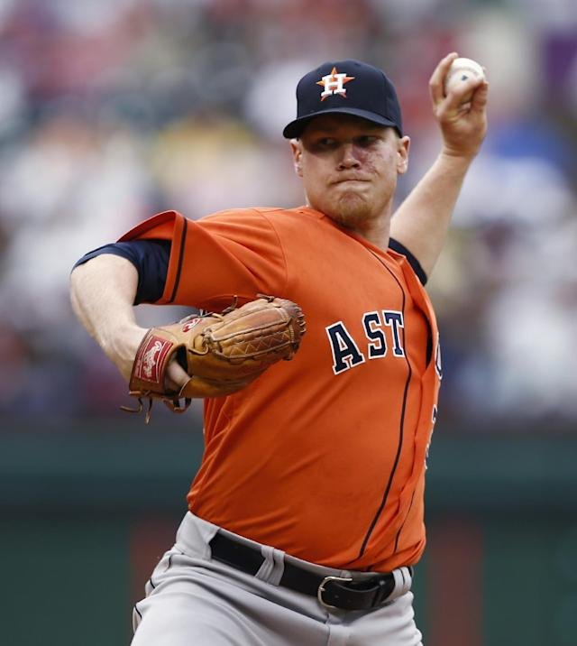 Houston Astros starting pitcher Brett Oberholtzer delivers a pitch to the Texas Rangers during the first inning of a baseball game, Sunday, April 13, 2014, in Arlington, Texas. (AP Photo/Jim Cowsert)
