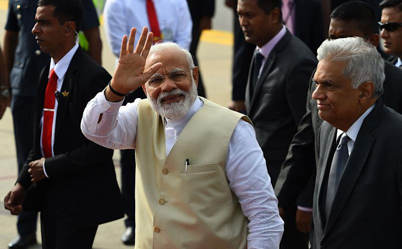 Indian Prime Minister Narendra Modi (C) waves on his departure as Sri Lankan Prime Minister Ranil Wickremesinghe looks on at Bandaranaike International Airport in Katunayake, near Colombo, on June 9, 2019. - India's Prime Minister Narendra Modi on June 9 made an unscheduled stop at a Catholic church bombed during the Easter suicide attacks ahead of his official welcome to Sri Lanka. (Photo by ISHARA S. KODIKARA / AFP) (Photo credit should read ISHARA S. KODIKARA/AFP/Getty Images)