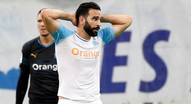 Adil Rami lost his job under truly bizarre circumstances. (REUTERS/Philippe Laurenson)