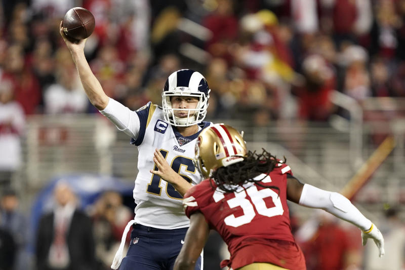 Los Angeles Rams quarterback Jared Goff (16) throws a pass as San Francisco 49ers defensive back Marcell Harris (36) applies pressure during the second half of an NFL football game in Santa Clara, Calif., Saturday, Dec. 21, 2019. (AP Photo/Tony Avelar)